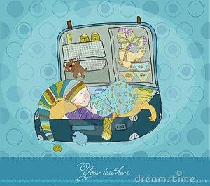 neonato-che-dorme-valigia-16592179
